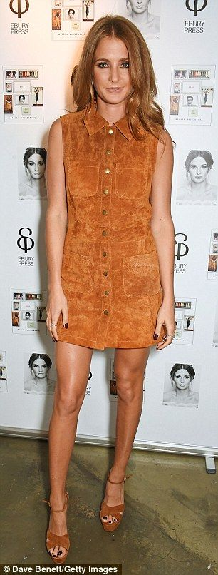 Style star: Millie teamed her flattering little dress with a pair of towering wood-effect ...