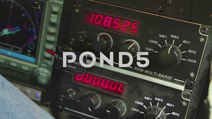 Pilot's Hand Turning Controls On Cockpit Panel, Connecting To Radio Channel-Stock Footage | by motortion