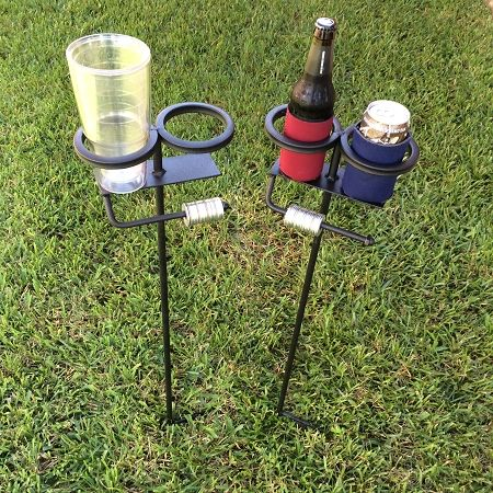 Skolder Stands™  You've probably seen drink holders for the yard but none that keep your outdoor game score like Skolder Stands™. Great for corn hole, washer toss, ladder toss, polish horseshoes and horseshoes. These are a must have for all outdoor gamers and tailgaters! Simply stake them in the ground using the welded foot step, drop your drink in place and let the games begin!