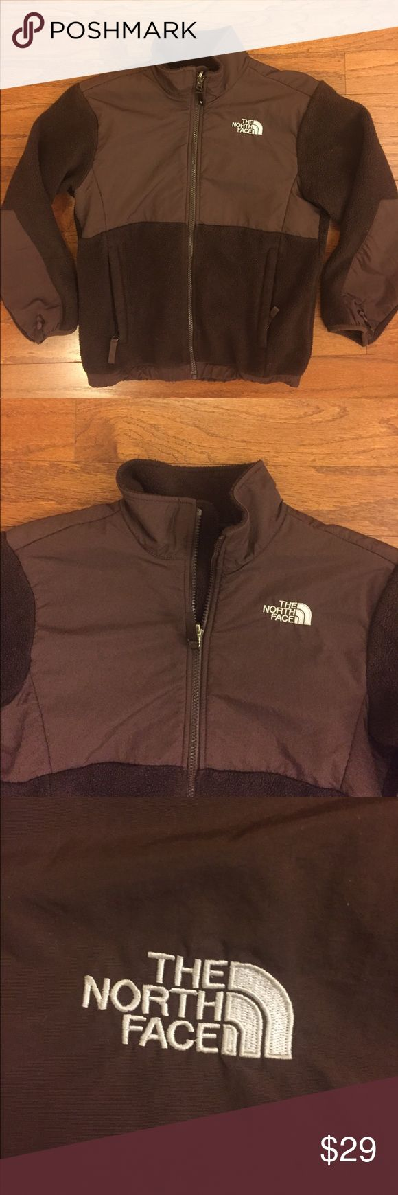 "Girls ""The North Face"" Fleece Zip Up Jacket Good condition with some normal wear, brown color with The North Face logo stitched on the front left chest and back right shoulder, made of 100% polyester and nylon material, girls size medium, measurements are about 20"" pit to pit, 22"" top to bottom and 19 1/2"" shoulder to cuff, Great looking Jacket, Excellent North Face Quality! Bundle for an Extra Discount! The North Face Jackets & Coats"