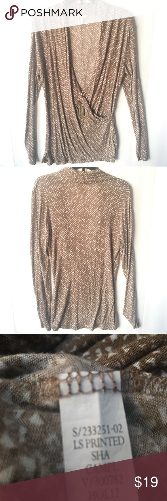 """Banana Republic Long Sleeve Wrap Front Top Soft and stretchy!  So soft you want to sleep in it. Banana Republic makes such classic designs that never become dated. This wrap-effect top drapes in front. Can be worn alone or with a cami.  Has been worn twice at the most and in excellent condition. Approximate length from shoulder to hem is 28"""".   Color: camel Size: S 95% modal (rayon) 5% spandex Banana Republic Tops"""