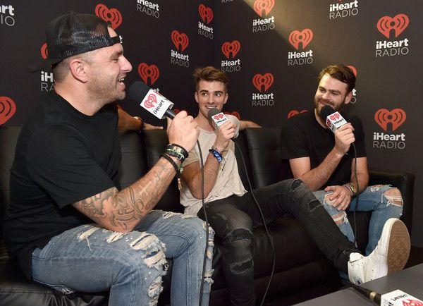 Andrew Taggart Photos Photos - (L-R)  Radio personality Billy The Kidd, DJ's Andrew Taggart and Alex Pall of The Chainsmokers speak backstage during the 2016 Daytime Village At The iHeartRadio Music Festival at the Las Vegas Village on September 24, 2016 in Las Vegas, Nevada. - 2016 Daytime Village at the iHeartRadio Music Festival on September 24, 2016
