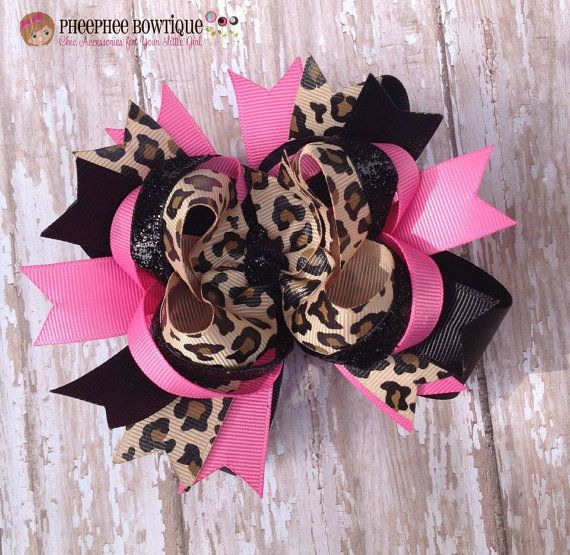 New Item Leopard, Hot Pink and Black OTT Layered Loopie Double Stacked Bow This handmade bow measures approx. 5 inches wide (great for infants, toddlers, big girls, teens and adults) and is made of quality grosgrain ribbon in coordinating colors layered with a smaller bow, loops and spikes and Button center. Bow comes securely attached to a partially lined single prong alligator clip so it can be worn with the head band or can be worn seperately (for trendy teens and adults). All ribbon ends…