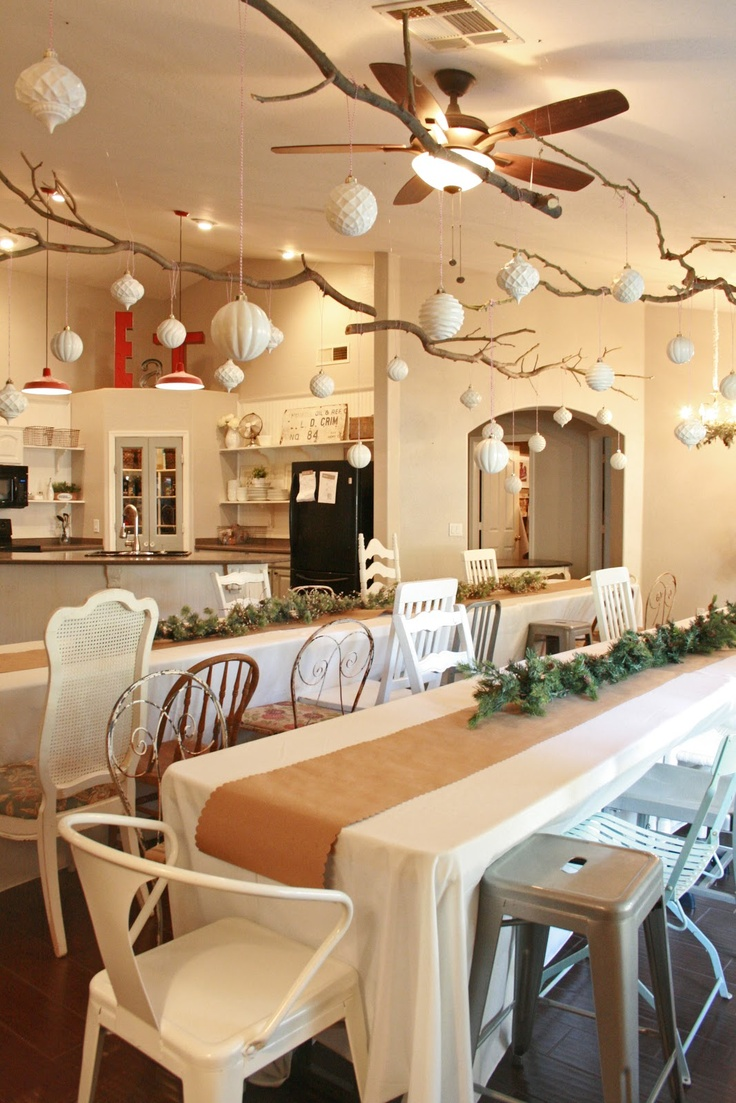 Holiday party decorating. Love the ornaments hanging from suspended branches.