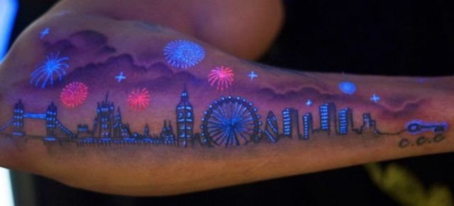 Tattoo that is visible under an ultraviolet light