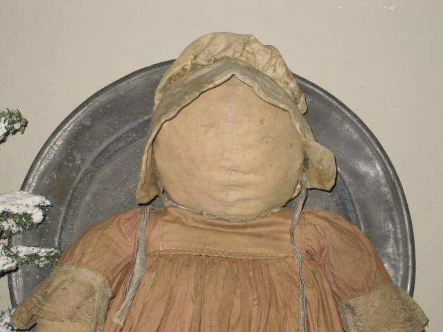 Early Large Size Stuffed Doll wearing a handmade brown dress.....mitten hands and shaped feet.....