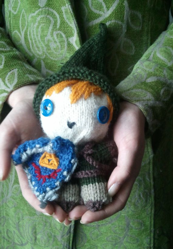 Its dangerous to go alone ... TAKE THIS  This hand-knitted, chibi-fied amigurami of Link from The Legend of Zelda: Twilight Princess, is complete with a removable green hat, Hylian Shield, and scabbard.  As the Hero of Time once said, ...  The last picture shows my Midna amigurami, available in this listing alone: https://www.etsy.com/listing/237938450/midna-midna-doll-twilight-princess?ref=shop_home_active_5 Or this listing, with Link: https://www.etsy...