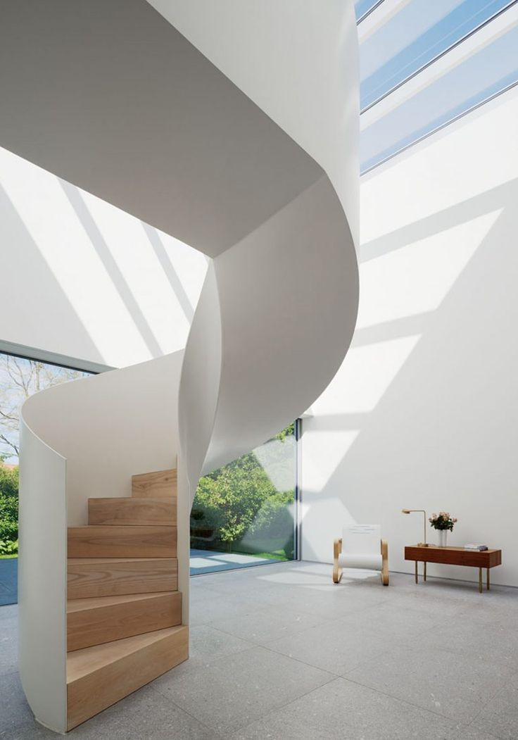 Love this minimalist spiral staircase. The skylights also provide for fun lighting patterns to stream onto the floor