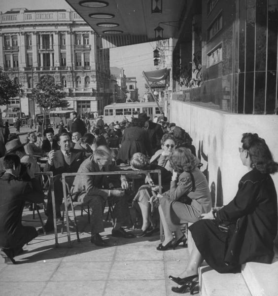 People eating at King George's sidewalk cafe.Location:Athens, Greece  Date taken:1948  Photographer:Dmitri Kessel