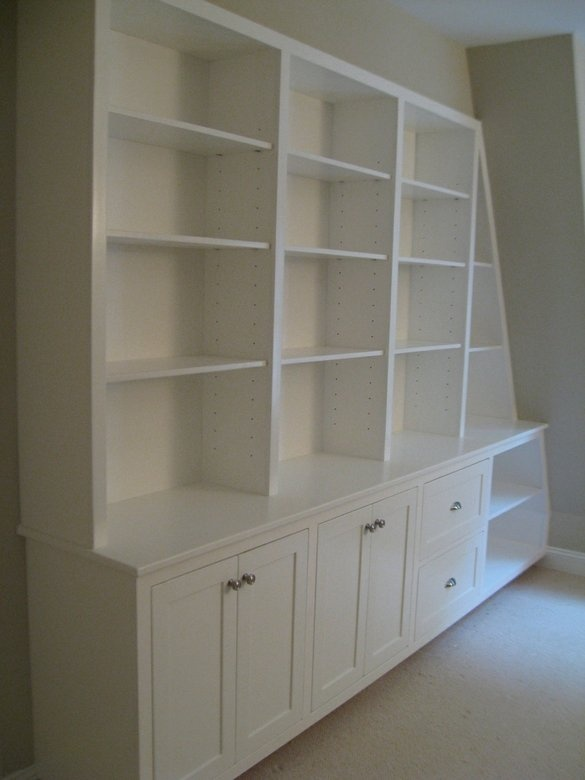 Built-in bookcase (like deeper cabinets for more storage). I like this for when we finish off the attic!!!