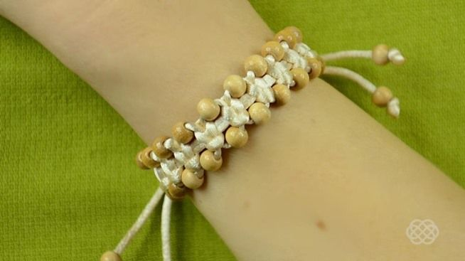http://jewelry-crafts.wonderhowto.com/how-to/diy-arm-candy-square-knot-beaded-stackable-bracelet-0150390/