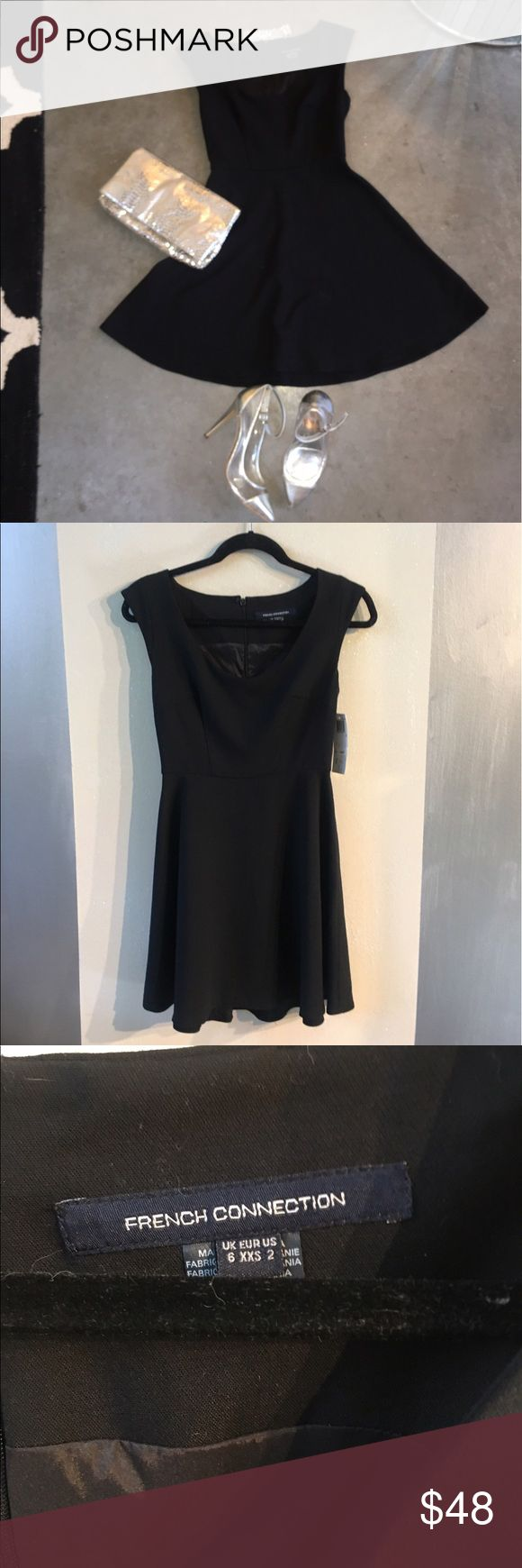 💋HUGE DISCOUNT 💋 NWT French Connection Dress Gorgeous black, fit and flare French Connection dress with a v neck cut and a center zipper down the back.  This dress is brand new with tags and will look great for many different occasions. French Connection Dresses