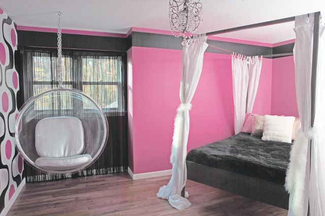 I designed this room especially for a very dramatic young lady. I selected the pinkest pink I could find (she couldn't get enough of pink - even the sheets are pink!). It's a combination of 60's style and Princess Glam... The feature wall was hand painted and inspired by vintage geometric prints.