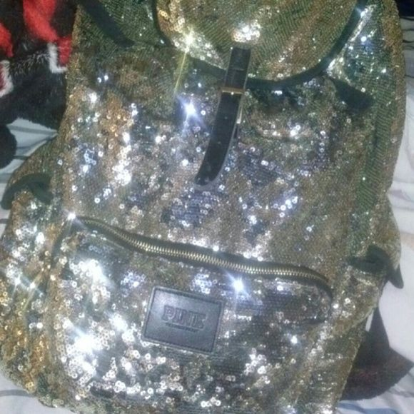 Shop Women's Silver Gold size OS Backpacks at a discounted price at Poshmark. Description: Worn. 8/10 condition because there's a rip on the inside lining of the hood. The front pocket has two little sequins missing. Very comfortable & stylish, perfect for school. Fits backpacks & has a lot of room. I fit about 1 binder & 4 notebooks and still has room. Limited edition as well. Full size. Ill post better pictures later. Will take REASONABLE OFFERS. Sold by nathalienuo...