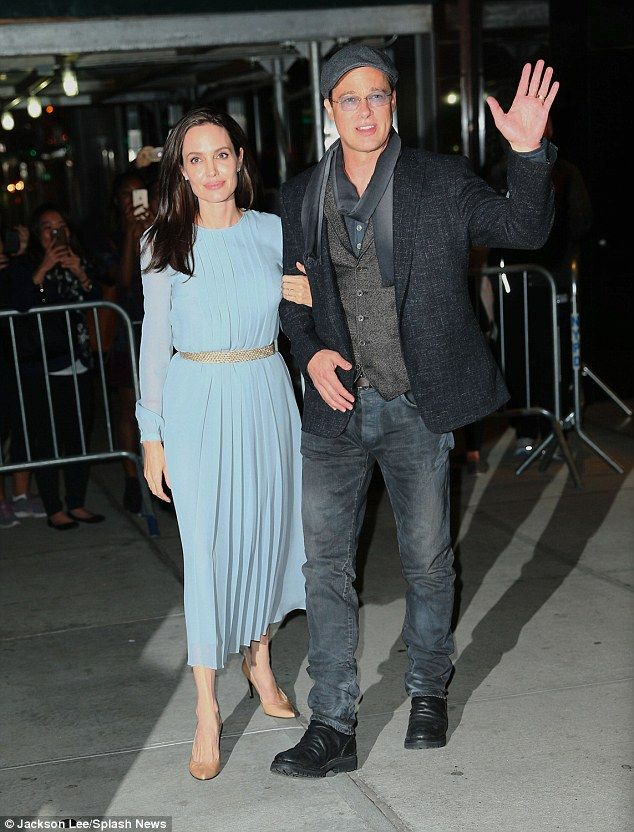 Supporting each other: The actress linked her arm through her husband's as the duo posed for pictures outside the Directors Guild of America theatre, while linking arms