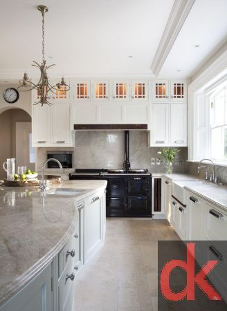 Luxury hand painted kitchen cabinetry with walnut kitchen cabinetry doors with burr walnut accents.  Curved glass kitchen doors with custom inlay.  Exotic stone worktops along with custom made dining table and chairs.  Traditional Kitchen Design