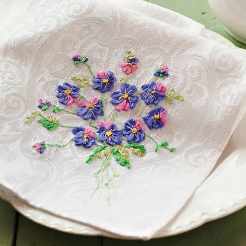 Ribbon embroidered pansies on table linens perfect for