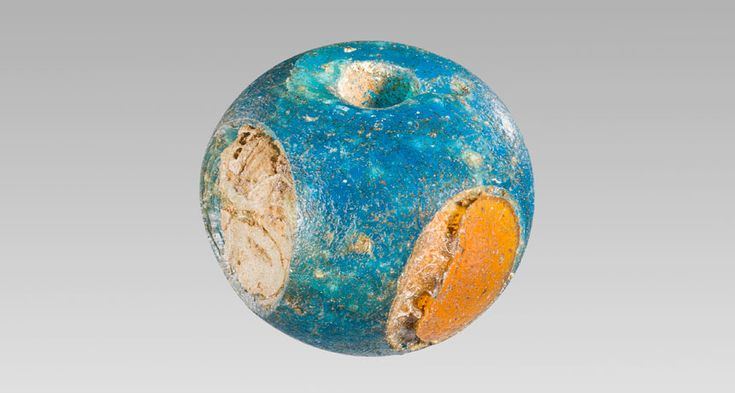A chemical analysis pinpoints Mesopotamia as the source of this glass bead, featuring inlaid eyes of yellow and white glass. The bead was discovered in a 3,400-year-old Danish grave.  Credit: A. Mikkelsen, National Museum of DenmarkNews
