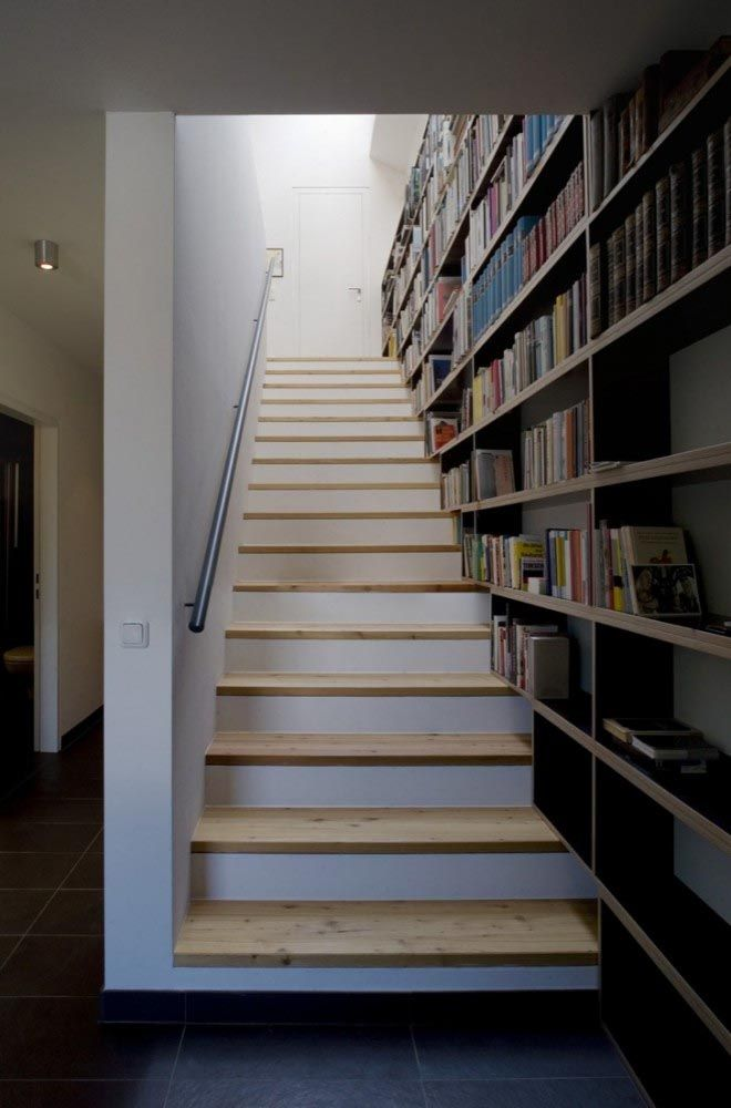 Modern Minimalist Wooden House Design steps. Great use of space for books.