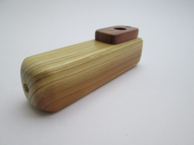 Handmade wooden Kazoo. The body wood is Redwood, the top is Cedar. The screws are made out of brass. Size approx. 5 1/16 inch long x 1 5/8 inch tall x 1 1/4 wide Available at Spuzzo.com