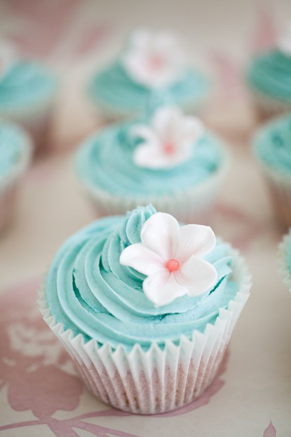 Beautiful teal cupcake w/ white flower -underfill cupcake so frosting stays neat inside liner