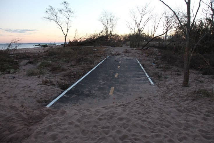 A small road along Cedar Grove Beach in New Dorp was covered by sand.   [http://lightbox.time.com]