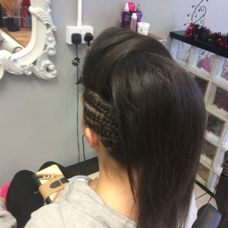 A mohawk inspired updo with side plaits and side sweeping bump
