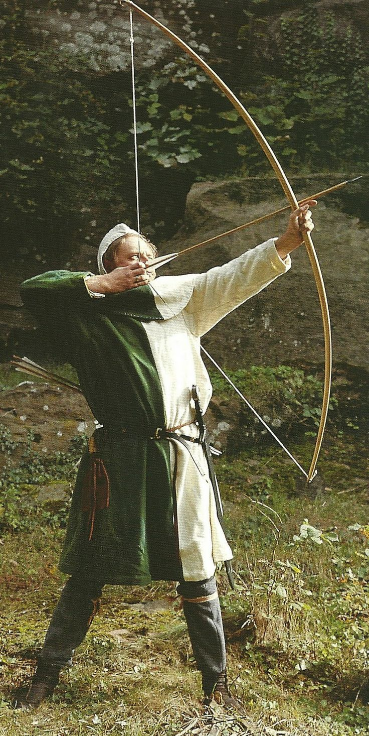 A recreation of the half white, half green dress ordered by Edward, the Black Prince, for his Welsh Bowman in 1346