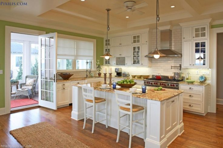 This is a great kitchen. Then go out the door into a large, sunny craft room.