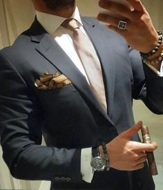 The pocket is on the wrong side and a real gentleman would know that you never smoke a cigar with the band on.  Watch ison wrong hand and what is he wearing on left wrist.  My goodness.