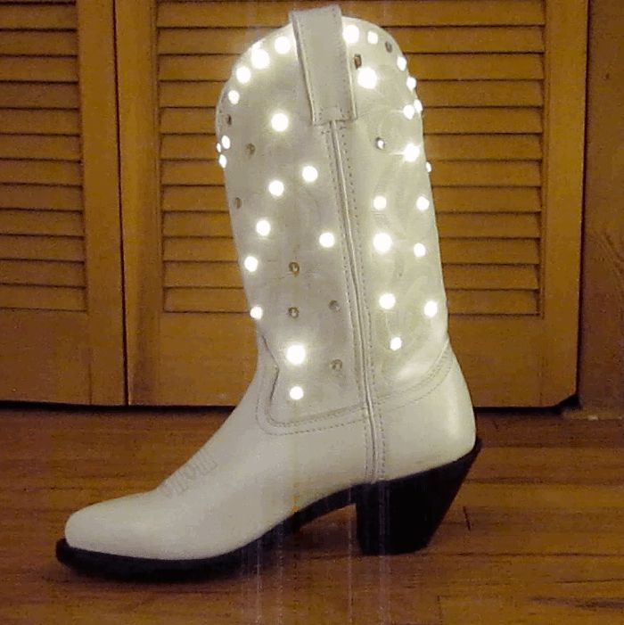 OMG OMG! Play that GIF, rhinestone cowgirl, and witness the magic. Sparkling LED Light Up Cowboy Boots CRED = Kacey Musgraves + Enlighted Illuminated Clothing
