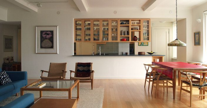 Open kitchen with double sided hanging maple framed glass cabinets