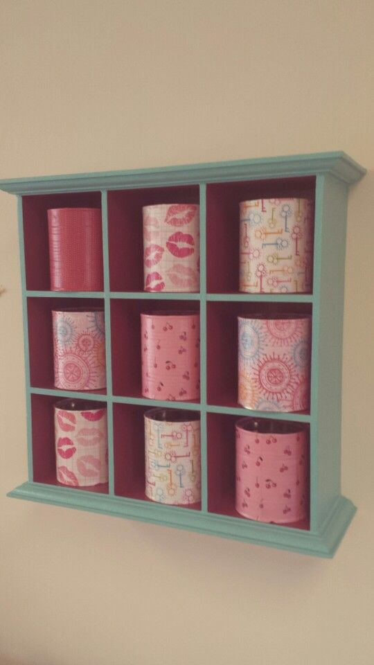 Storage in my craft room. Two tone paint on an old hutch/shelf/thing and modge podged baby formula cans!