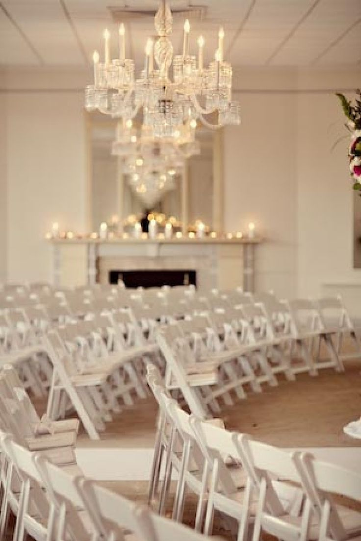 Beautiful all white wedding ceremony with chandeliers and candles for illumination. #wedding #decor