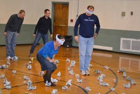 This was a new game we tried this year. A land mine field is set up in an open space. (We taped wadded up balls of newspaper to the gym f...