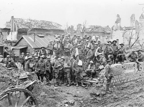 © IWM (E (AUS) 1067) Australian soldiers outside a bath house near Ypres on 1 November 1917. Regular attendance at bath houses was compulsory for all troops on the Western Front.