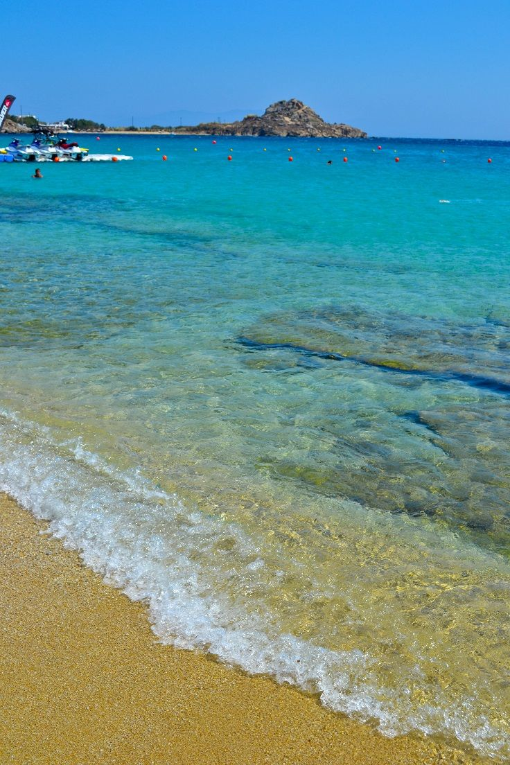 Platis Yialos Beach - Mykonos, Greece: For my money, this is the best beach on Mykonos. No party kids, no pebbly sand. Just crystal clear aquamarine waters, soft sand and a relaxing, family-friendly vibe for a perfect day at the beach.