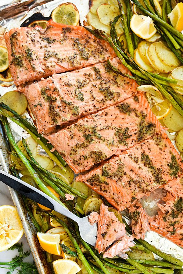 An easy mustard sauce flavors this sheet-pan salmon recipe with caramelized asparagus and potatoes roasted along side for a super simple dinner with minimal clean-up.