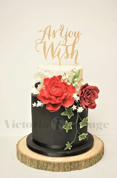 Perfect for a Snow White / fairy tale theme wedding. Black, Ivory and red wedding cake. Double barrelled Red Velvet cake, carrot cake top tier. Gum paste peony, rose, anemone and snow drops.