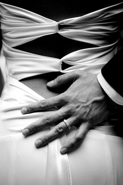 Sensual black and white of a bride and groom's intimate moment