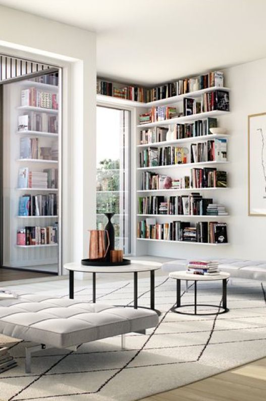 Modern grey living room with white bookshelves