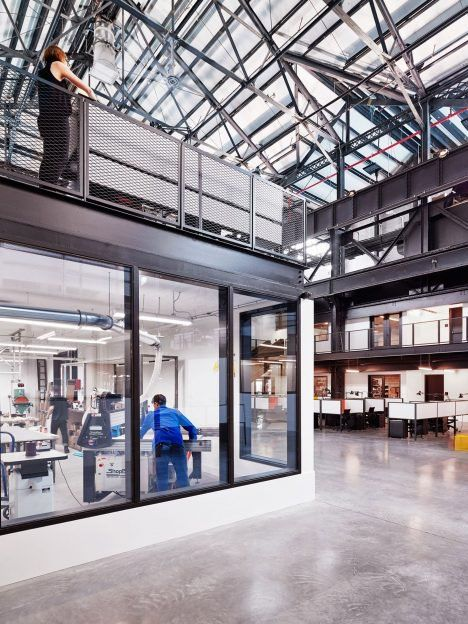 Facilities in this warehouse conversion by Macro Sea include offices, private studios and lofts, as well as shared amenity spaces like lounges and meeting areas.