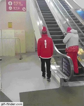 Swiss Olympic skier Fabian Bösch rides the escalator with one arm