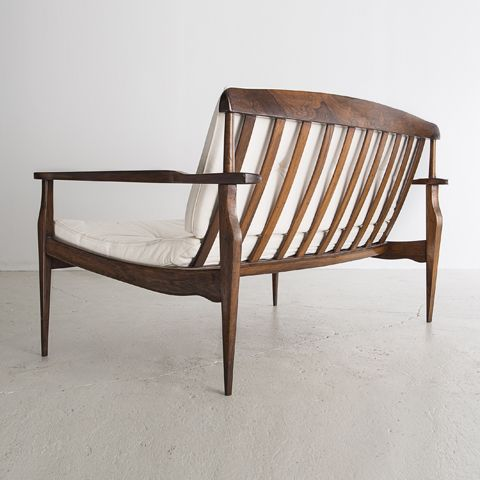 Settee in jacaranda with sculpted armrests, Joaquim Tenreiro. 8 Amazing  Examples of Midcentury Modern Design from Brazil Photos
