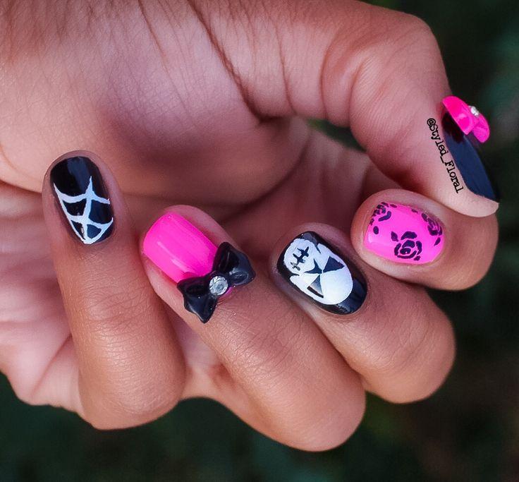 Girly Halloween inspired floral nail art design! Skulls ...