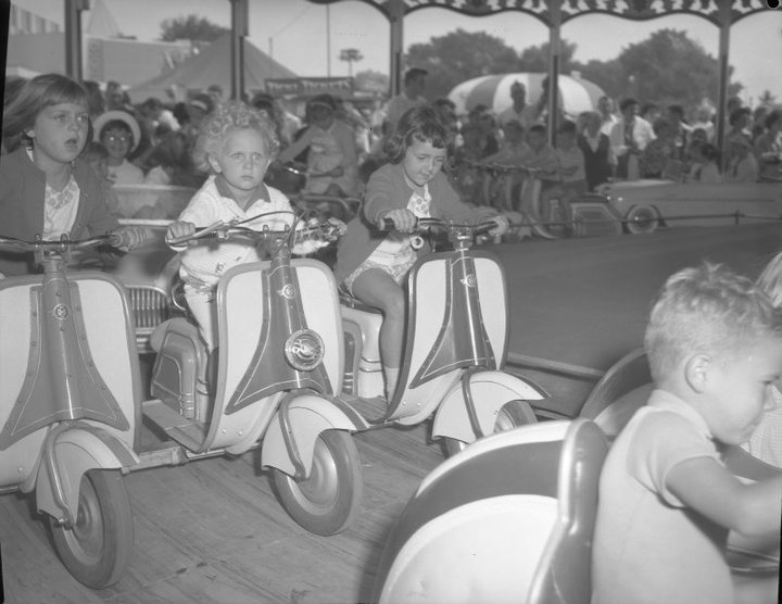 The wind in his hair and a look of amazement, CNE Midway ca. 1963