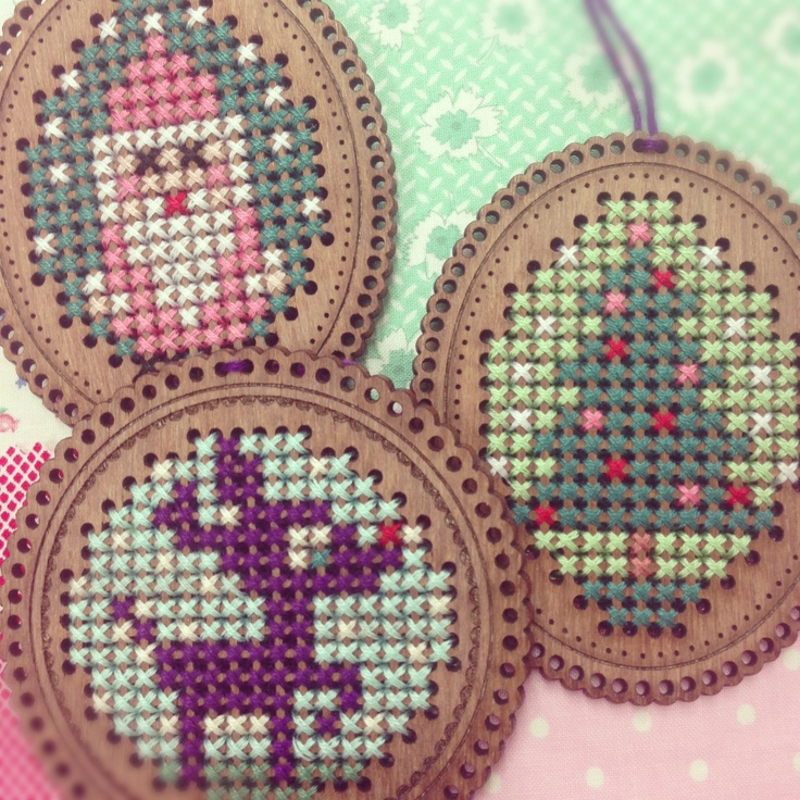 Cute xmas charts & timber cross stitch frames designed for the [make it] brand by Leutenegger.