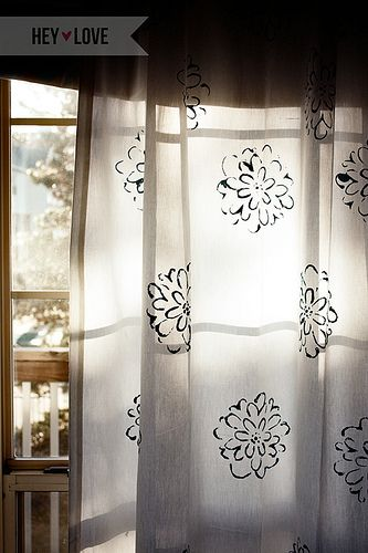 Stenciled curtains.  Cute!