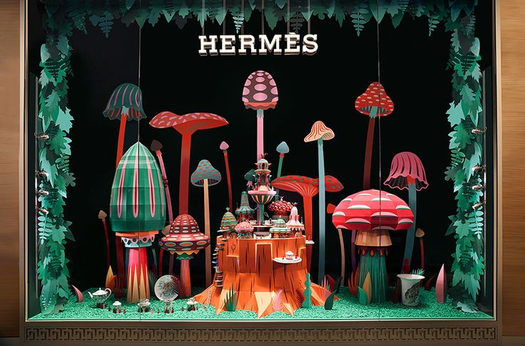 zim & zou have crafted a colorful paper universe for the window display of a new Hermès store in dubai at the mall of the emirates.