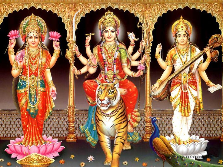 Goddess Lakshmi (left) and Goddess Durga (center) and Goddess Saraswati (right)